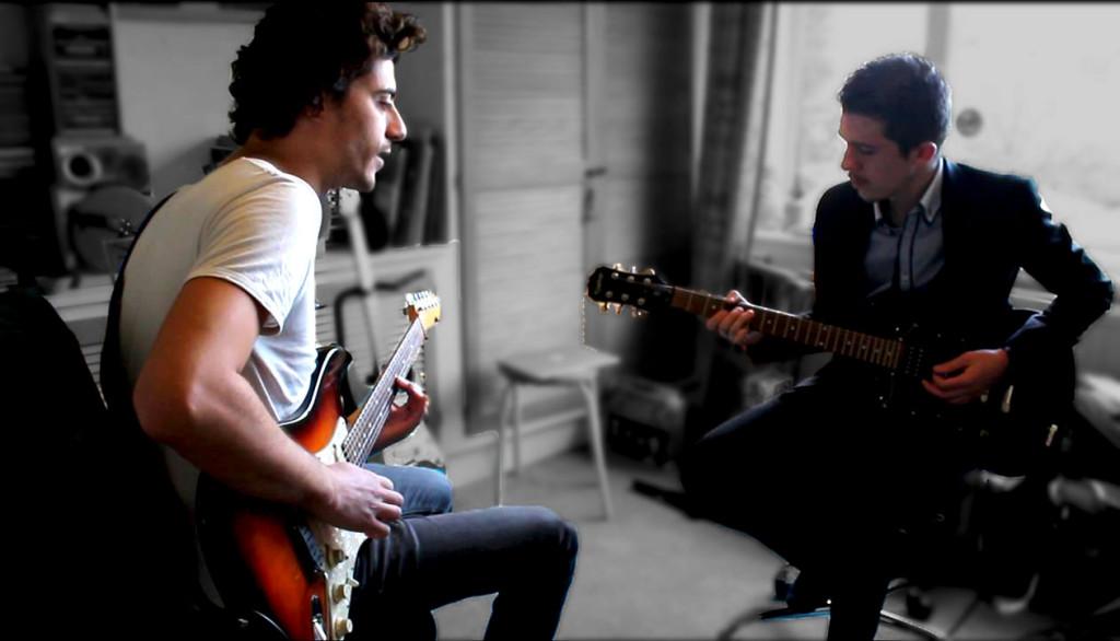 Guitar Teacher and pupil